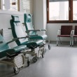 Stock Photo: Empty chairs in hospital.