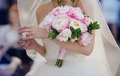 Bride with her peonies bouquet — Stock Photo