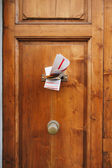 Magazines in a letterbox of a door — Stock Photo