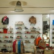 Interior of a casual clothes and shoes store - Stock Photo