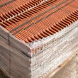 Stock Photo: Stack of roofing tiles packaged