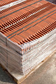 Stack of roofing tiles packaged — Stock Photo