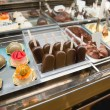 Stock Photo: Variety of sweets products at cafe