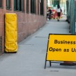 Businesses open as usual sign — Stock Photo