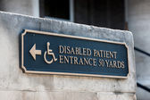 Disabled handicap entrance entrance sign — Stock Photo