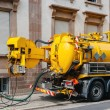 Stock Photo: Sewerage truck on street working