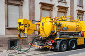 Sewerage truck on street working — Стоковое фото