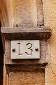Thirteen house number plate — Stock Photo