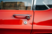Detail of a vintage red car — Stock Photo