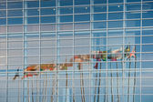 Eurozone flags reflectig in EU Parliament building — Foto Stock