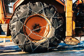Snow chains on tractor tire — Stockfoto