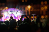 Photographing with smartphone during a public concert — Stock Photo