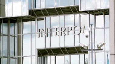 Interpol logo on building — Stock Video