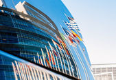 European Parliament building reflected in car windshield — Stock Photo