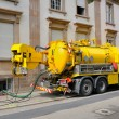 Sewage truck working in urban city environment — Stock Photo #49599181