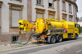 Sewage truck working in urban city environment — Stock Photo