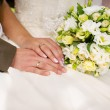 Wedding rings and flower bouquet — Stock Photo #14240701
