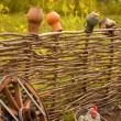 Stock Photo: Craft pots on the fence