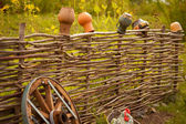 Craft pots on the fence — Stock Photo