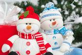 Handmade snowmen under Christam tree — Stock Photo