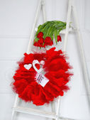Love garland and red flowers — Stock Photo