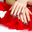 Dark fashion manicure on red - Stock Photo