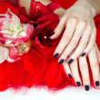Spa treatment for woman hands with flowers — Stock Photo #19415713