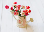 Still life with flowers in the watering pot — Stock Photo