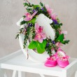 Royalty-Free Stock Photo: Pink orchid wreath and kid\'s shoes