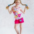 Girl with two funny pigtails — Stock Photo