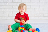 Little boy and constructor blocks — Stock Photo