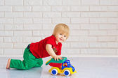 Kid playing with a toy car — Stock Photo