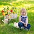 Laughing kid on the grass in the garden — Stock Photo