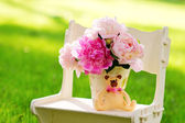 Still life with peonies on the lawn — Stock Photo