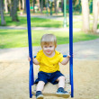 Cute boy on the swing — Stock Photo