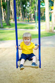 Cute boy on the swing — Stock Photo