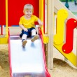 Cute kid on the slide — Stock Photo