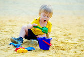 Cute kid in the sandpit — Stock Photo