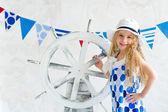Girl with steer wheel — Stock Photo