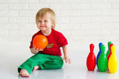 Little boy playing bowling — Stok fotoğraf
