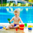 Toddler by the pool with toy bucket set — Stock Photo