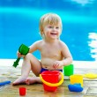 Toddler by the pool with toy bucket set — Stock Photo #29548149