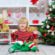 Cute and happy little boy and Christmas stocking — Stock Photo #35683693