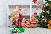 Cute and happy little boy and Christmas stocking — Stock Photo