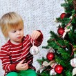 Little boy and Christmas tree — Stock Photo #36069687