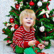 Little boy and Christmas tree — Stock Photo