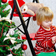 Little boy and Christmas tree — Stockfoto