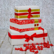 Wrapped gift boxes and beads — Photo
