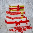 Wrapped gift boxes and beads — Stock Photo
