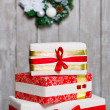 Wrapped gift boxes and Christmas wreath — Photo